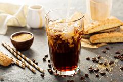 Iced coffee being poured in a glass Stock Images
