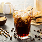 Iced coffee being poured in a glass Royalty Free Stock Photography