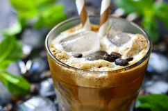 Iced coffee on black background. Iced coffee in a glass on black background royalty free stock photo
