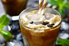 Iced coffee on black background. Iced coffee in a glass on black background stock photo