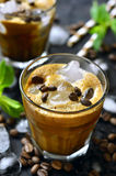 Iced coffee on black background. Royalty Free Stock Image