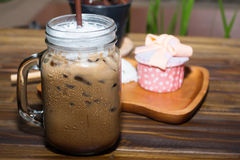 Iced coffee with blueberry cheese cake Royalty Free Stock Images