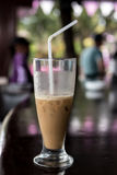 Iced coffee or caffe latte close up in pool bar. Bali island, Indonesia. Royalty Free Stock Photos
