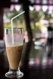 Iced coffee or caffe latte close up in pool bar. Bali island, Indonesia. Royalty Free Stock Images