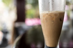 Iced coffee or caffe latte close up in pool bar. Bali island, Indonesia. Stock Photos