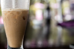 Iced coffee or caffe latte close up in pool bar. Bali island, Indonesia. Royalty Free Stock Image
