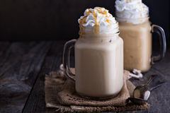 Iced coffee with caramel and whipped cream royalty free stock image
