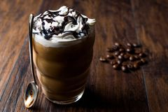 Iced Coffee Chocolate with Whipped Cream. Chocolate Syrup and Spoon. Beverage Concept Stock Image