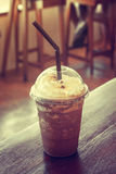 Iced coffee in coffee shop. Iced coffee on table in coffee shop, in vintage style stock photos