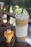 Iced coffee. Cold coffee and dessert on the table Royalty Free Stock Photos