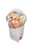 Iced coffee covered with whipped cream caramel in plastic glass to go stock photography