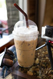 Iced coffee covered with whipped cream in in plastic cup Royalty Free Stock Photos