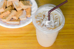Iced coffee and crackers. On the table Stock Photography