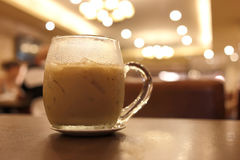 Iced coffee drink in cafe Stock Images