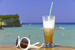 Iced coffee in an exotic beach Stock Photos