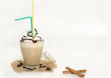Iced coffee with foam and cinnamon. Isolated Stock Photography