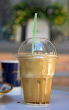 Iced coffee frappe in plastic cup stock photography