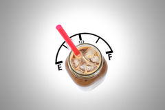 Iced Coffee. Fuel Gauge, Empty / Full Concepts on Iced coffee drink. Straw is the gauge Royalty Free Stock Image
