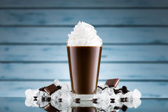Iced coffee in glass and crushed ice royalty free stock images