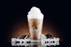 Iced coffee in glass and crushed ice stock images