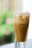 Iced coffee. Glass of iced milk coffee royalty free stock images