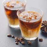 Iced coffee in glasses. Tasty fresh cold iced coffee with milk in glasses on table. Square stock photos