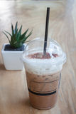 Iced coffee with green plant background Royalty Free Stock Photography