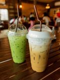Iced coffee and iced green tea latte. In plastic glass Stock Image