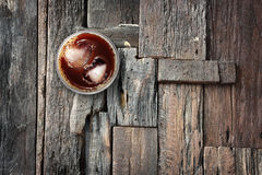 Iced coffee and ices in heart shape on wood floor. Royalty Free Stock Photos