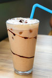 Iced coffee latte with chocolate sauce Royalty Free Stock Image
