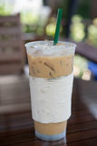 Iced coffee. Iced Latte coffee in clear plastic cup on table Stock Images