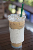 Iced coffee. Iced Latte coffee in clear plastic cup on table Royalty Free Stock Photography
