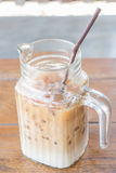 Iced coffee latte in glass pitcher up close Royalty Free Stock Photography
