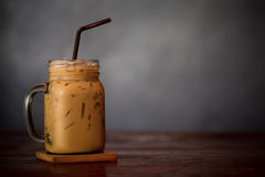 Iced Coffee Latte with Ice on Wood Table. stock photography