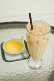 Iced coffee latte and pumpkin custard Stock Image