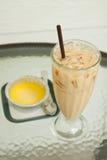 Iced coffee latte and pumpkin custard Stock Image