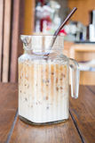 Iced coffee latte serving in glass pitcher Royalty Free Stock Photo