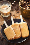 Iced coffee lollies. On black plate Stock Photo
