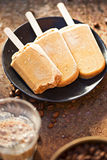 Iced coffee lollies. On black plate Royalty Free Stock Photography