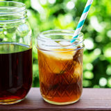 Iced coffee in mason jars outdoors Royalty Free Stock Photos