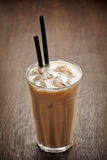 Iced coffee with milk. Glass of iced coffee with milk stock image