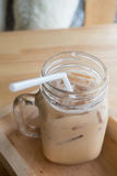 Iced coffee with milk. Is in Mason jar , on the table stock photo