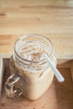 Iced coffee with milk. Is in Mason jar , on the table Stock Images