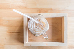 Iced coffee with milk. Is in Mason jar , on the table royalty free stock photos
