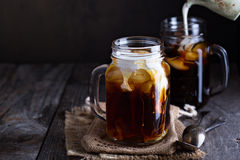 Iced coffee with milk in mason jars Royalty Free Stock Photo