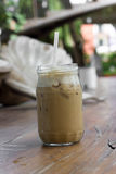 Iced coffee with milk is on the table. Royalty Free Stock Photo