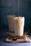 Iced coffee with milk in tall glasses Stock Photo