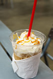 Iced coffee mocha in plastic cup on the table Stock Images