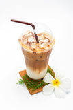 Iced coffee in plastic cup and Plumeria Royalty Free Stock Image