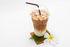 Iced coffee in plastic cup and Plumeria Stock Photo